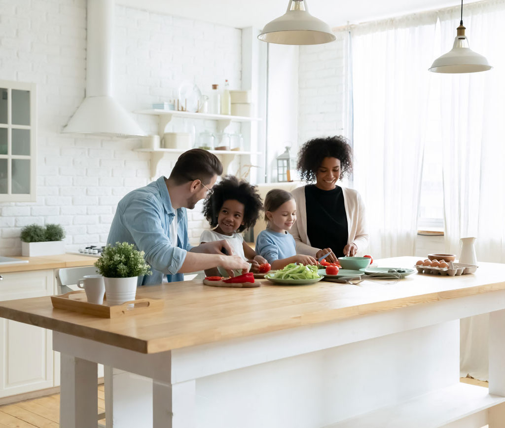 Happy-family-cooking-meal-together-at-home-kitchen